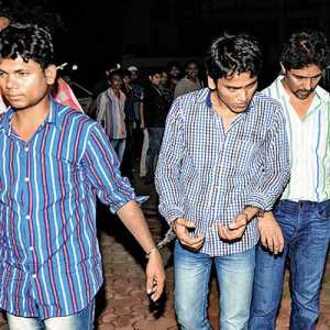 pimps arrested in a high-profile sex racket case being taken into custody on Friday