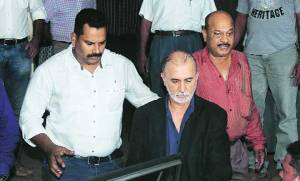 Tarun Tejpal being taken for medical tests after his arrest, in Panaji on Saturday night 30-11-2013