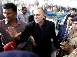 Tarun Tejpal, founder and editor-in-chief of Tehelka, speaks with the media at the airport on his way to Goa, in New Delhi -Reuters